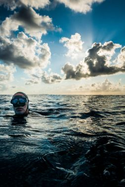 SAN ANDRES ISLAND, Colombia - Circa March 2017: Freedivers at the surface During a Beautiful Sunset in the Caribbean Ocean