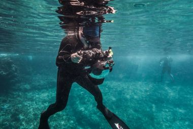 SAN ANDRES ISLAND, Colombia - Circa March 2017: Freediver Photographer with Large Dome, Camera Housing and Gopro in Caribbean.