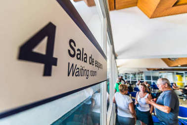 SAN ANDRES ISLAND, Colombia - Circa March 2017: Door number four in the Waiting Room at the San Andres Airport.