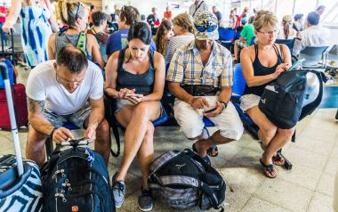 SAN ANDRES ISLAND, Colombia - Circa March 2017: Few People With Tablets and Phones in the Waiting Room at the San Andres Airport.
