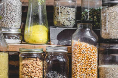 Close-up of a Few Seeds, Grain and Cereals in Glass Containers.