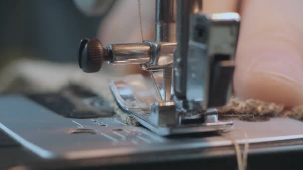Close-Up Sewing With Burlap Fabric On A Sewing Machine. Repair Fabric By Sewing Machine. Handmade Garment Industrial Concept. 4k Video