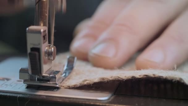 Close-Up Mans Hands Sew With A Sewing Burlap Fabric On A Sewing Machine. Repair Fabric By Sewing Machine. Handmade Garment Industrial Concept. 4k Video