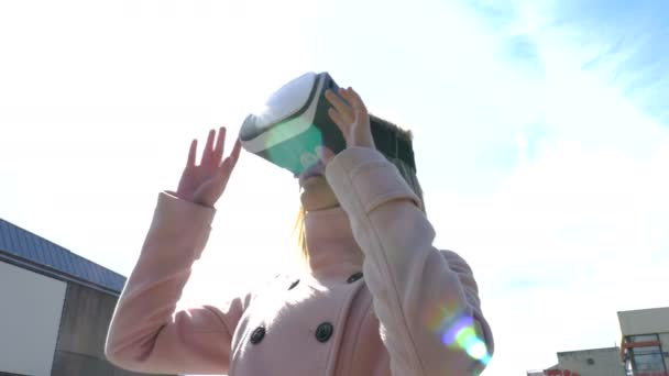 A Girl Wearing a Virtual Reality Headset Under Bright Sunlight