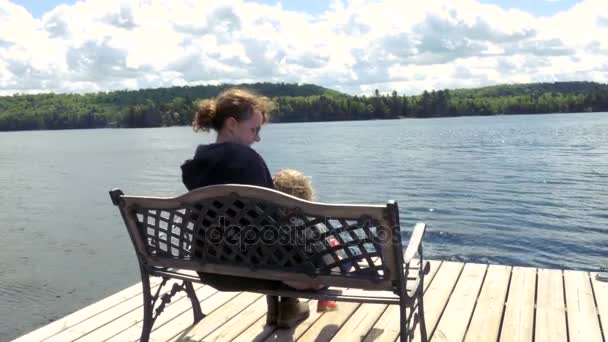 Mother and Child Sitting on a Pier Bench on Georgian Bay
