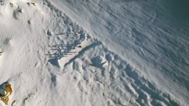 Overhead of Skiers on an Alpine Slope