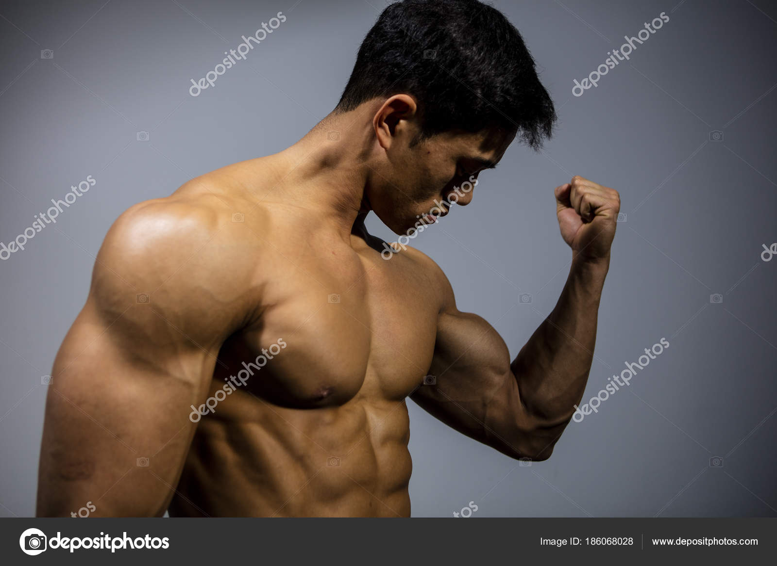 Fitness Model Flexing Bicep Muscle Stock Photo Nektarstock