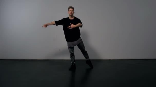 Male Dancer in Studio Shows Ballerina Spin