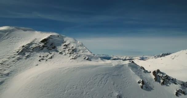 Wintry Passo del Tonale Mountainous Landscape and Blue Sky