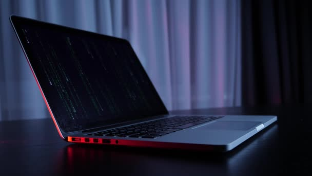Computer screen with matrix code. Laptop with matrix on screen on the table, isolated. Computer Hacking. Dark screen hacker. Security, online, virus, coding, protection, social concept. Slow motion