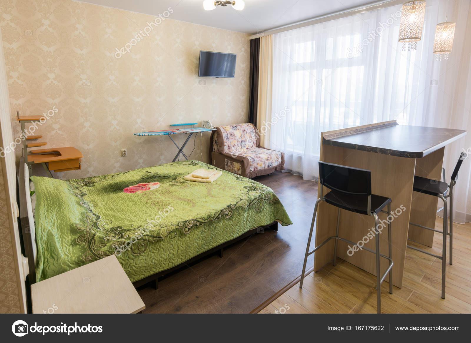 https://st3.depositphotos.com/2143661/16717/i/1600/depositphotos_167175622-stock-photo-interior-of-a-bedroom-with.jpg