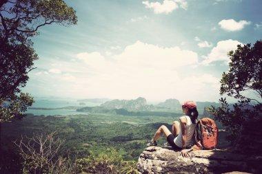 successful woman backpacker hiking