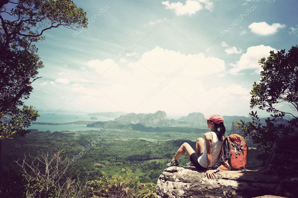 successful woman backpacker hiking