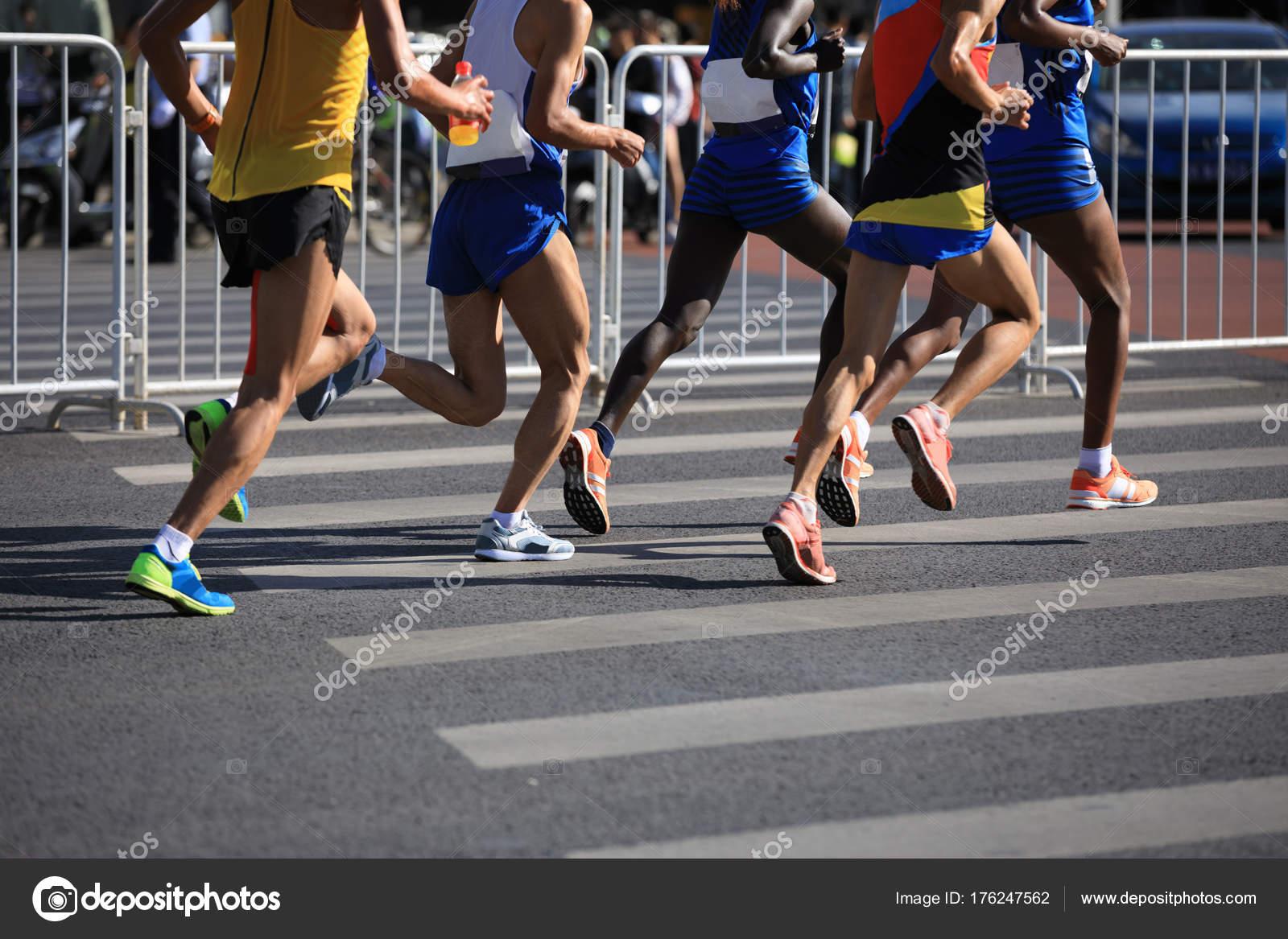 Female Male Marathon Runners Running City Road Stock Photo