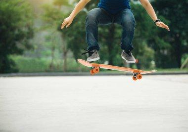 Cropped image of skateboarder skateboarding on parking lot stock vector