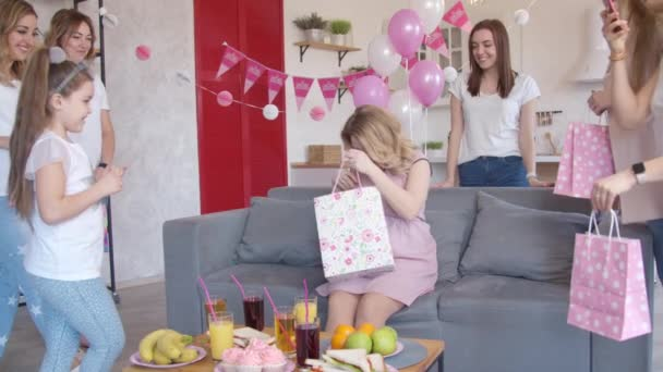 Girl giving gift to pregnant woman