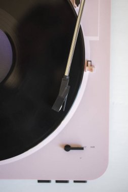 Vintage music record player with a vinyl record
