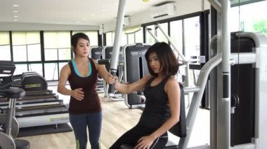 Trainer and Athlete at training equipment workout exercise