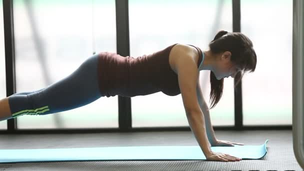 Cute woman at gym push up push-up workout exercise