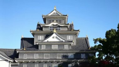 Zoom front view of Okayama Castle in morning with blue sky