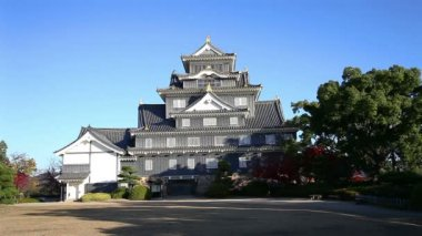 Front view of Okayama Castle in morning with blue sky
