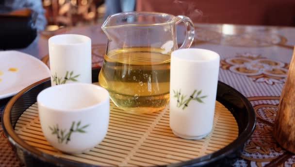 White tea cup and white smoke.