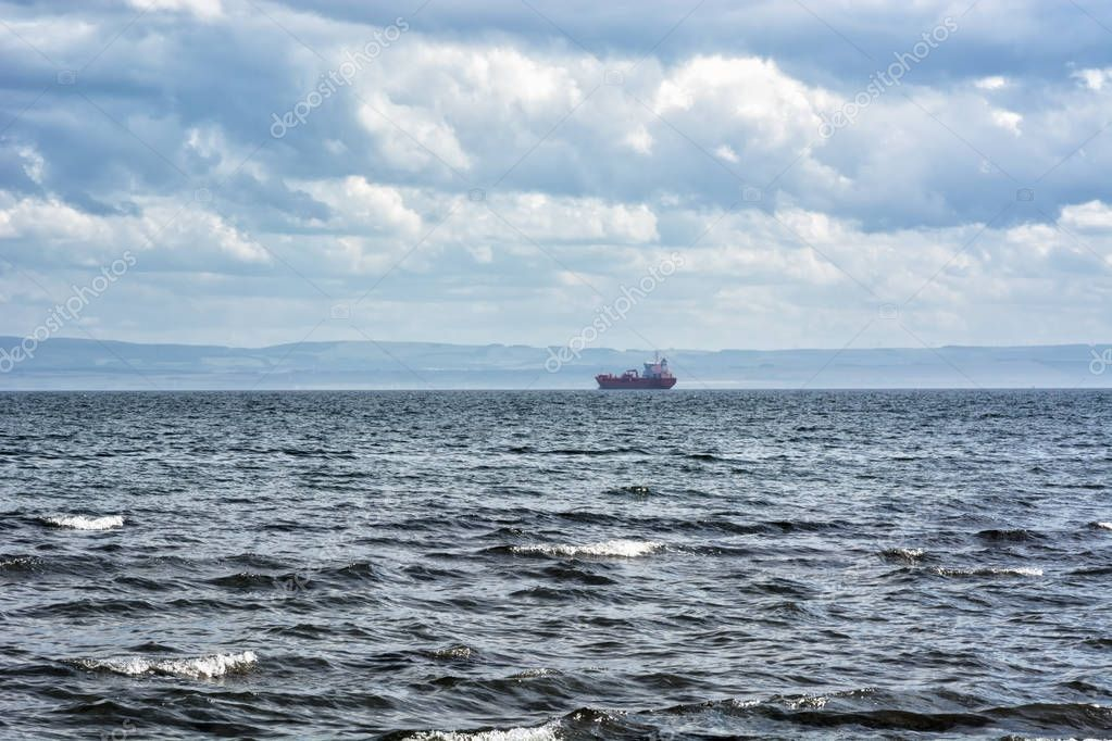 Cargo ship on the horizon in Kirkcaldy, Scotland