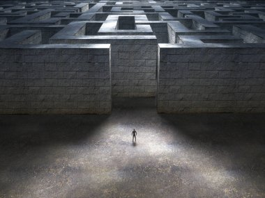 Man standing at the entrance of a huge stone maze.