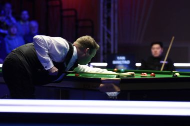 Shaun Murphy of England plays a shot to Yan Bingtao of China at the semifinal of 2020 Players Championship in Southport, the United Kingdom, 29 February 2020