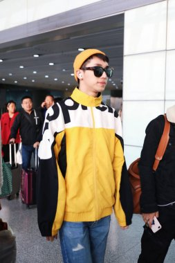 Chinese actor and singer-songwriter Xu Weizhou or Timmy Xu arrives at a Beijing airport after landing in Beijing, China, 29 February 2020.