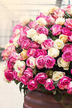 A huge bouquet of pink and white roses.