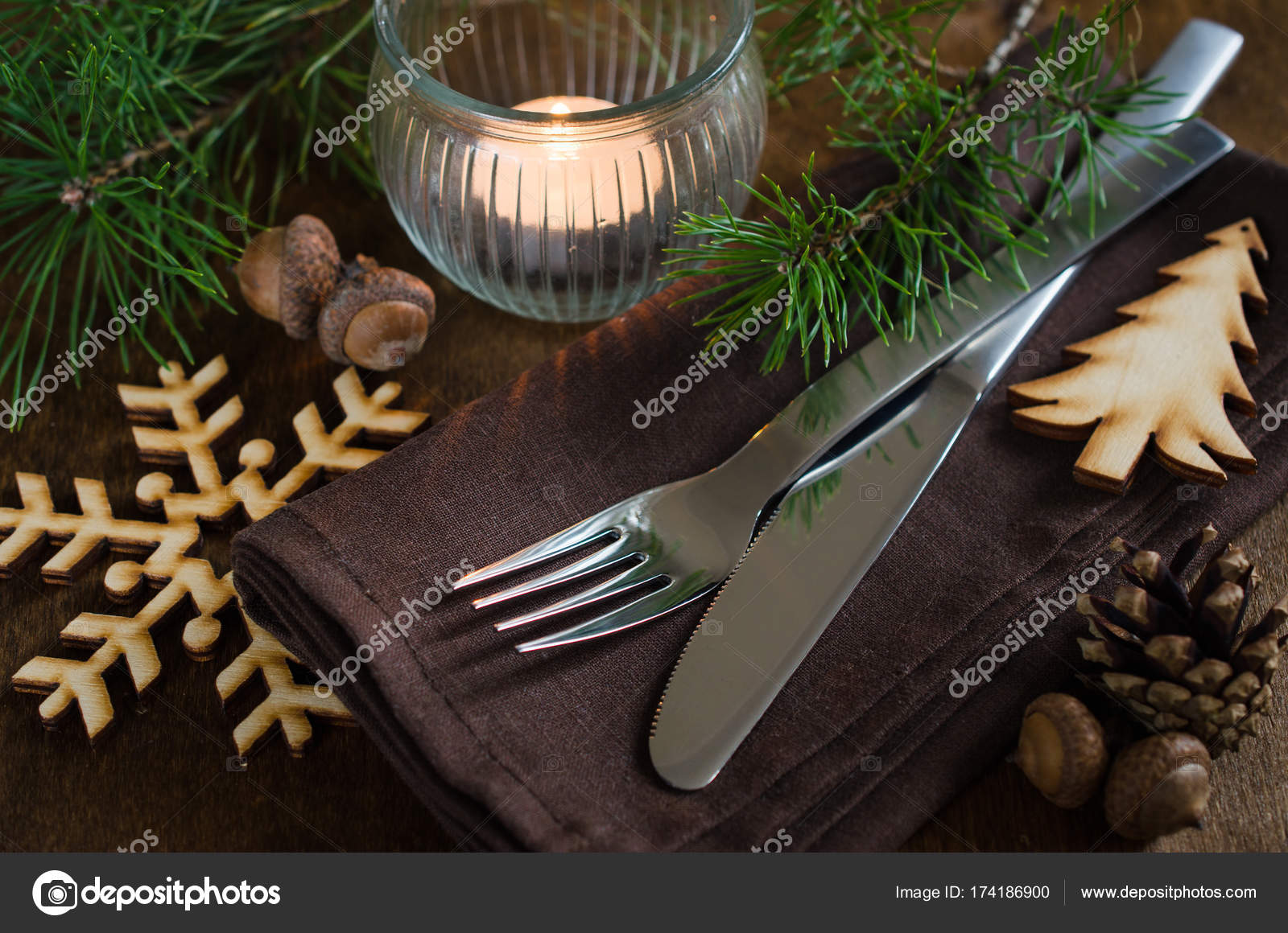 Rustic Christmas table setting with candle