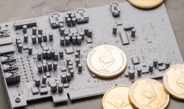 Crypto-currency: several gold-plated Ethereum coins on a gray circuit board