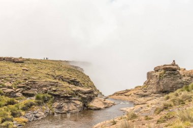 People at top of Tugela Falls, second tallest on earth