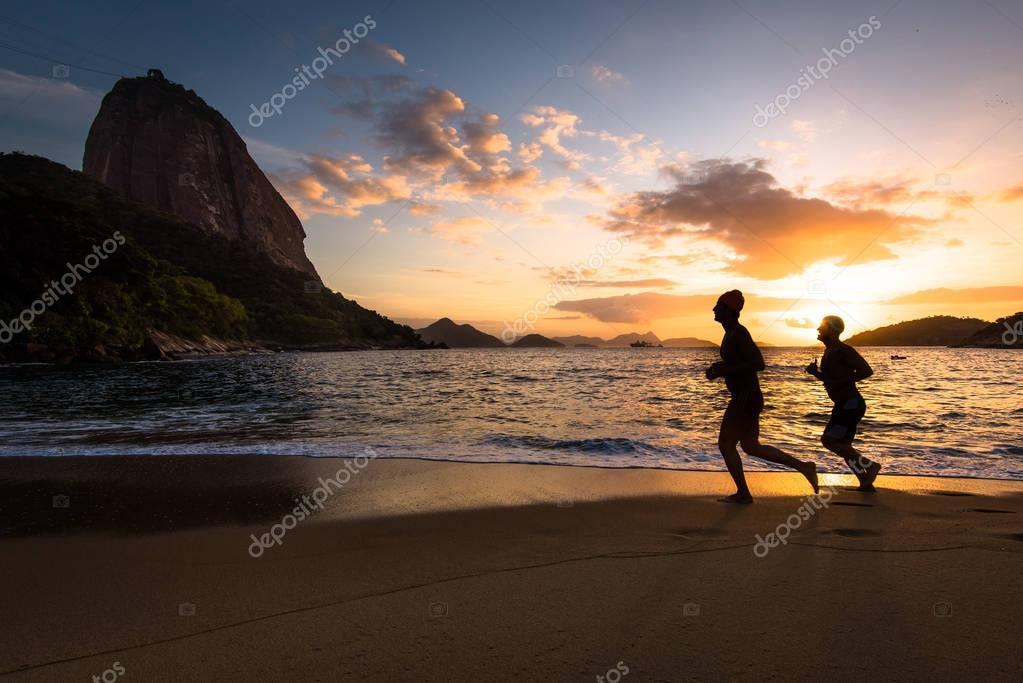 Men running at Red Beach