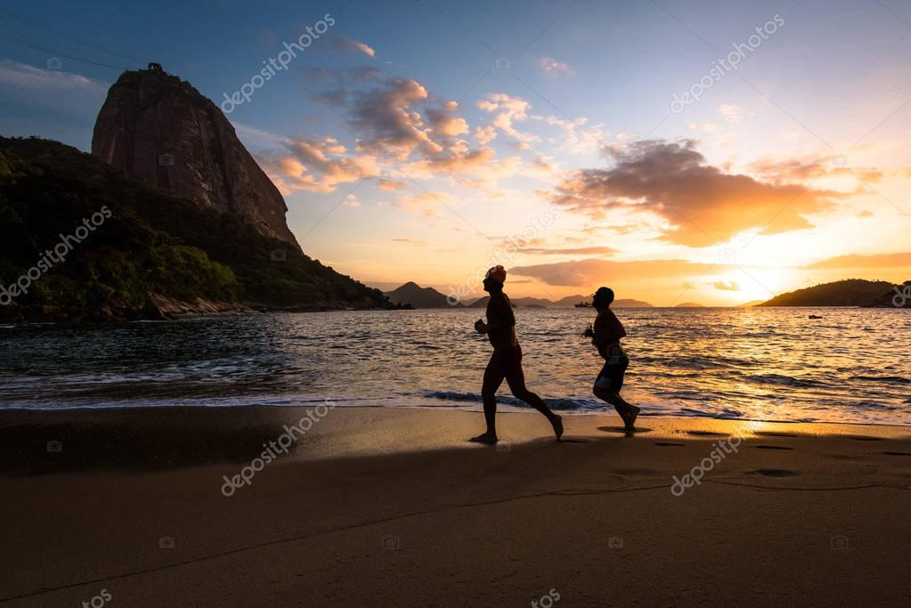 Men running at Red Beach
