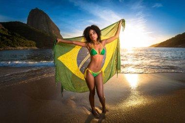 Girl With Brazilian Flag on the beach