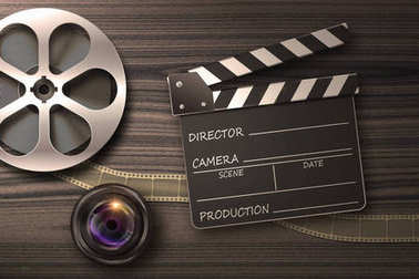 Clapperboards and the reel of film