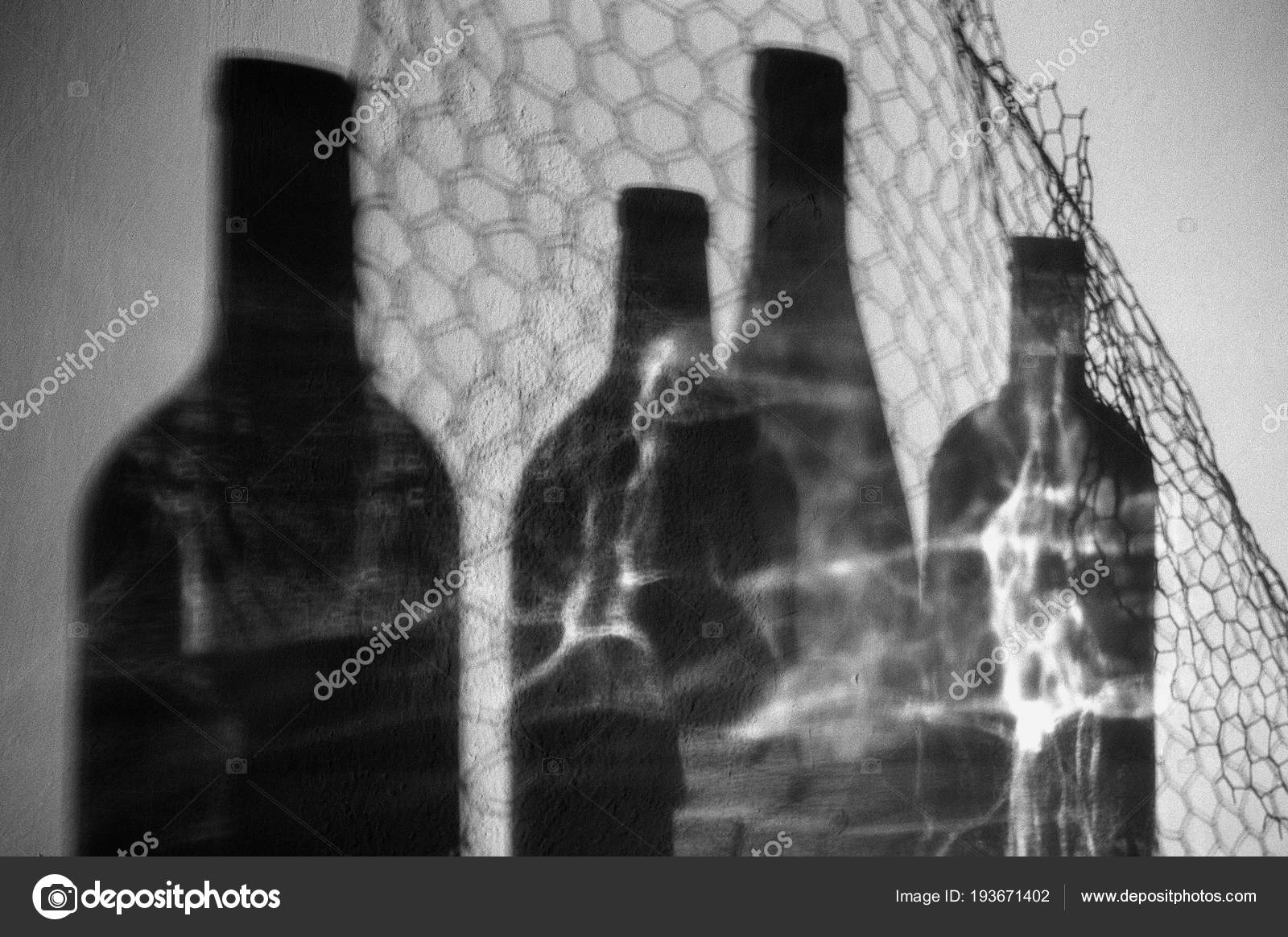 Black white artistic photography empty glass wine bottles shadows