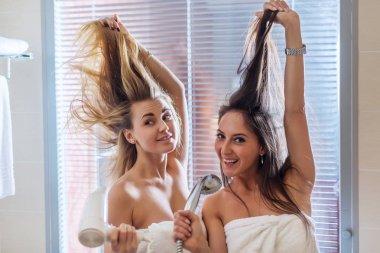 Funny women drying hair