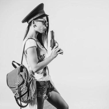 Fashion swag sexy girl blowing on smoke toy gun