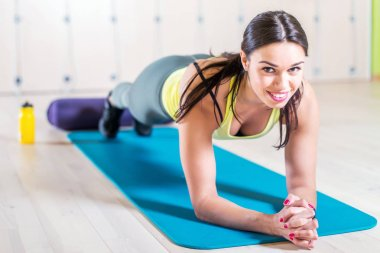 fitness training athletic sporty woman doing plank exercise