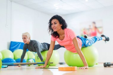Two women doing exercises in aerobics class