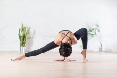 Fit modern dancer standing gracefully on tiptoe