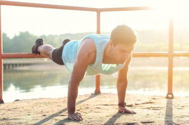Fit man doing push-ups