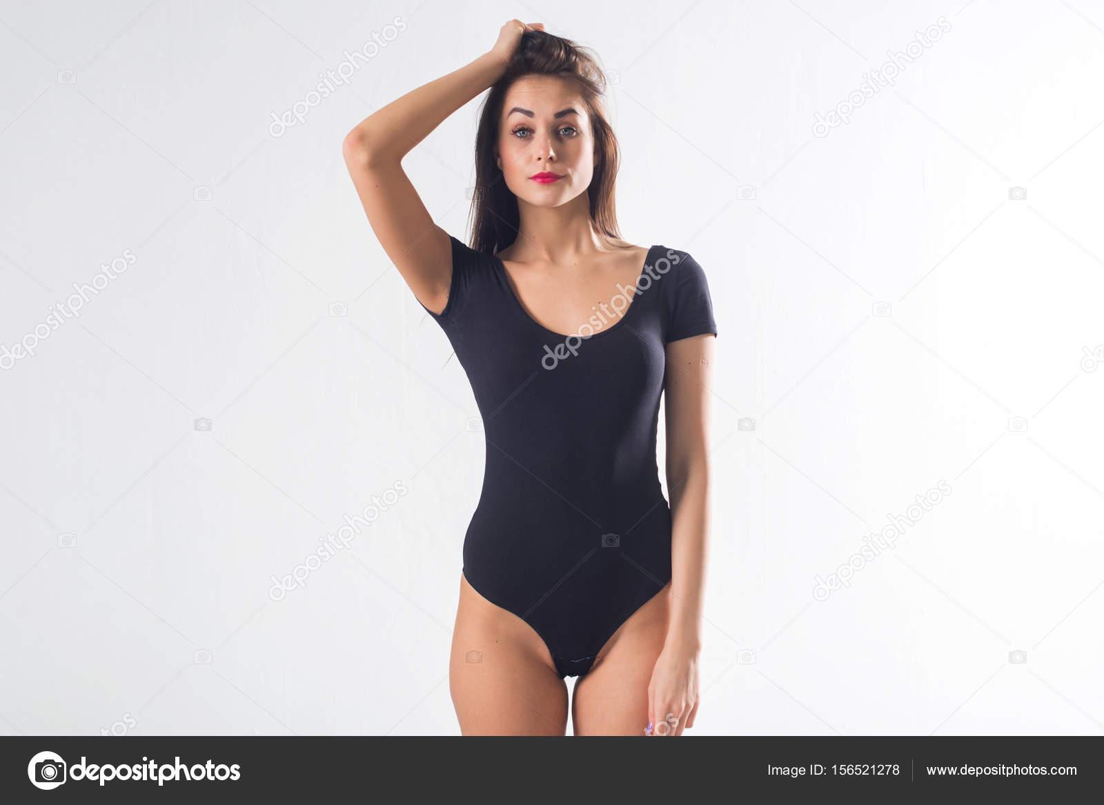 cute brunette female model posing, wearing black one piece underwear