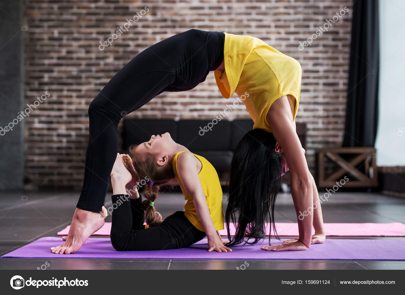Adult Woman And Child Girl Practicing Yoga Together At Home Standing In Bridge Pose Kid Doing King Cobra Posture Photo By Undrey
