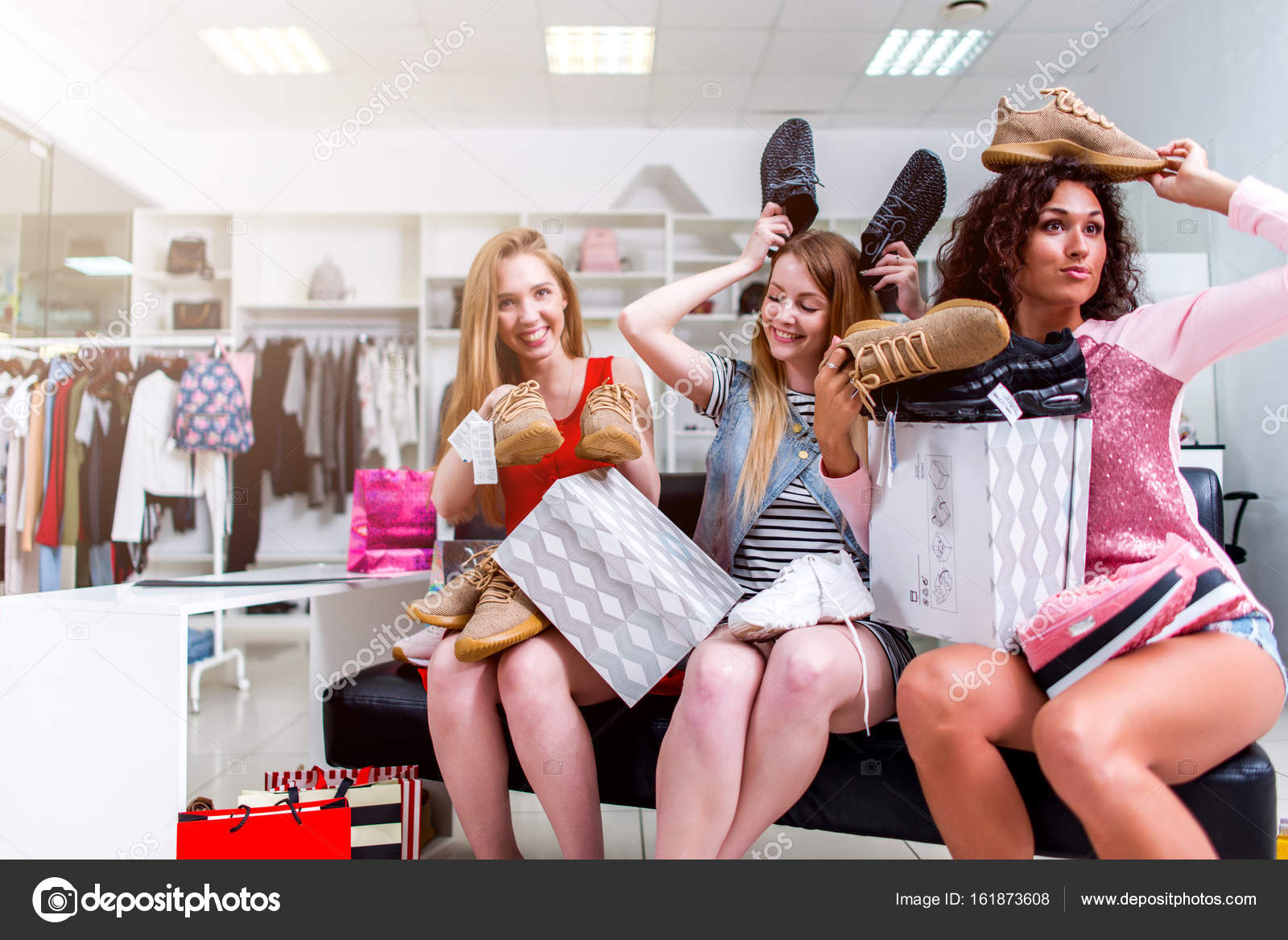 4fb464bfc41 Best friends doing shopping together fooling around with new shoes ...