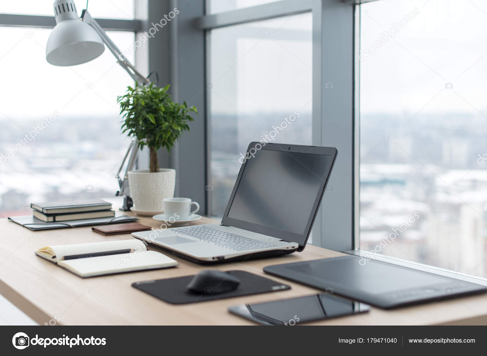 office work table. Workplace With Notebook Laptop Comfortable Work Table In Office Windows And City View. \u2014 Stock