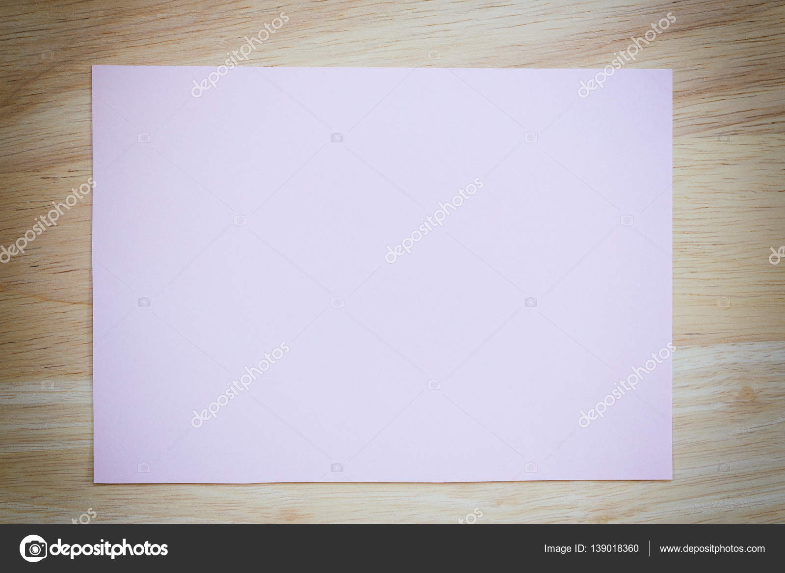 Popular Pink paper blank on the brown wooden floor of vintage color  LY44